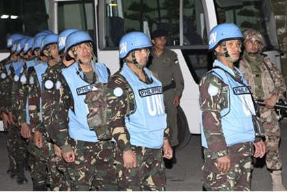 Filipino UN peacekeepers arrive at the headquarters of the Jordanian Army in Amman