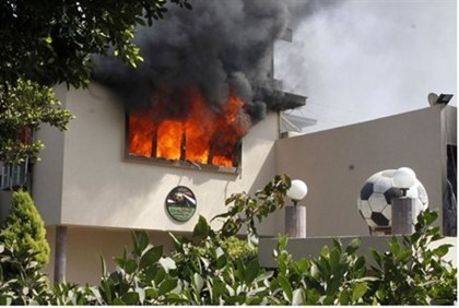 Flames rise from a room at the headquarters of the Egyptian Football Association in Cairo