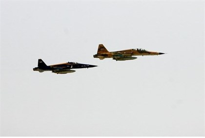 Iranian-made jets fly over the sea off the coast of Chabahar city, south of Iran
