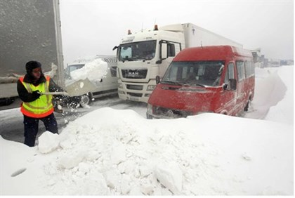 A member of the Hungarian rescue team tries to clear the road at the M1 highway