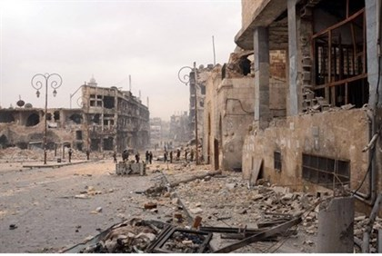 Syrian troops take position in a heavily damaged area in Aleppo