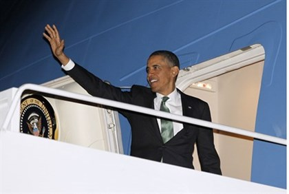 Obama waves as he steps aboard Air Force One on the way to Israel