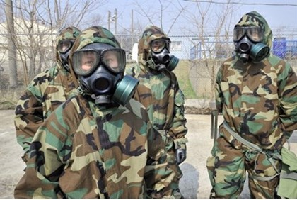 Soldiers of the US Army's 23rd Chemical Battalion wear protective gear