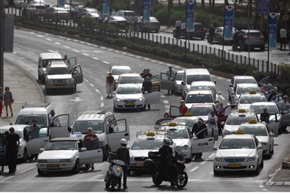 Israelis stand next to their vehicles as the siren sounds