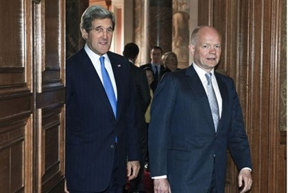 U.S. Secretary of State John Kerry walks with British Foreign Secretary William Hague