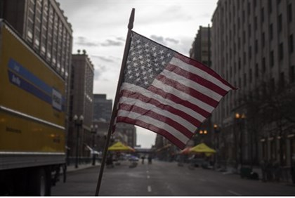 An American flag waves at site of Boston attack