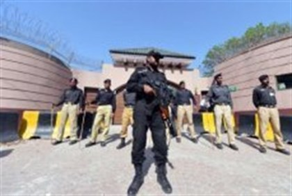 Pakistani police stand guard outside the residence of former Pakistani president Pervez Musharraf