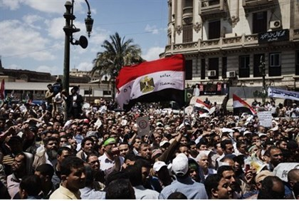 Muslim Brotherhood supporters protest in front of the High Court in Cairo