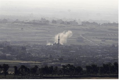 smoke rises from Syrian village