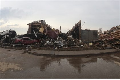 Destroyed buildings and overturned cars after a huge tornado struck Oklahoma