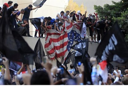 Egyptian rioters tear down US flag, 2012