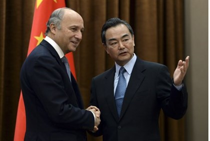 French, Chinese Foreign Ministers in previous meeting