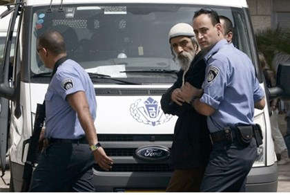 Ofer Gamliel being led to a 2009 court hearing