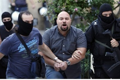Golden Dawn lawmaker Ilias Panagiotaros is led away by Greek anti-terrorism police