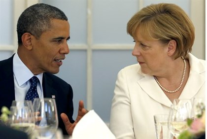 Happier times? President Obama with Chancellor Merkel