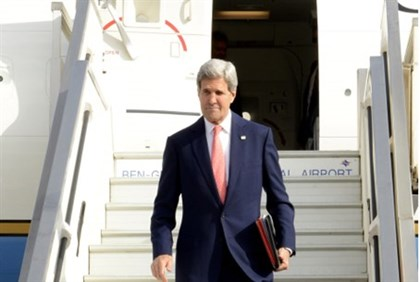 John Kerry, en route to Geneva