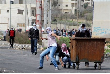 Arab rioters throwing rocks