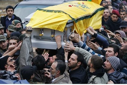 Hezbollah supporters carry the coffin of assassinated commander Hassan al-Lakiss at his funeral