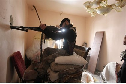 Free Syrian Army fighter aims his weapon, Aleppo
