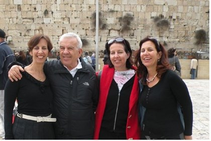 Dr. Eli Fischer with his three daughters at the Western Wall
