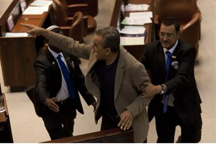 MK Jamal Zahalka escorted from Knesset plenum after disrupting debate