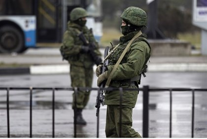 Armed men patrol at the Simferopol airport in the Crimea region