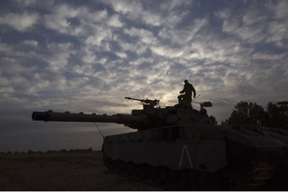 Only a matter of time? Israeli soldier stands atop a tank during 2012's Operation Pillar of Defense