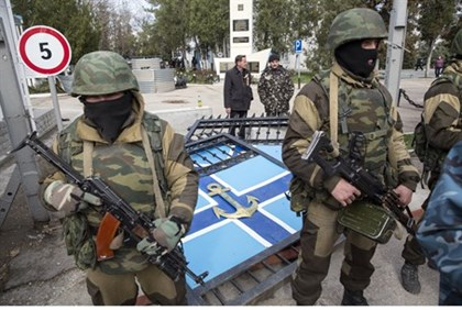Pro-Russian gunmen stand guard after seizing Ukrainian naval base in Sevastopol, Crimea