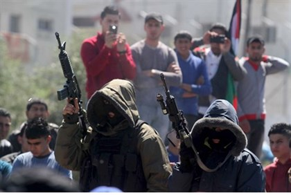 Gunman at the funeral of three terrorists killed in IDF operation