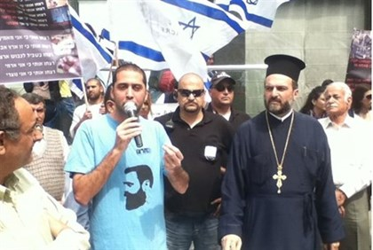 Sha'adi Mur'an Halul (L) and Father Gabriel Nadaf at Sunday's protest