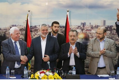 Senior Hamas, Fatah officials celebrate unity deal in Gaza