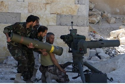 Syrian rebels prepare to launch an anti-tank missile in Idlib province