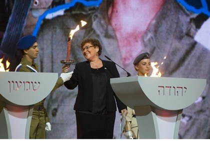 Miriam Peretz lights a torch