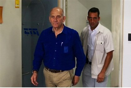 Olmert arrives for sentencing.