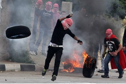 Arab rioters roll burning tires for 'Nakba Day'