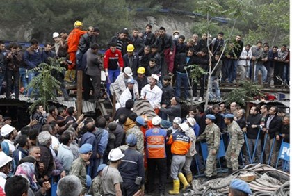 Rescuers carry a miner who sustained injuries after explosion in Soma