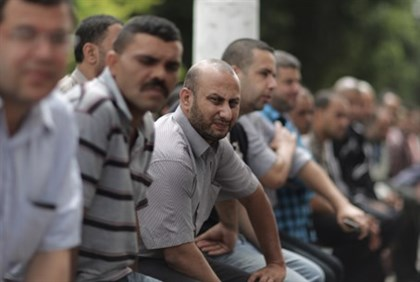 PA employees wait outside closed Gaza bank