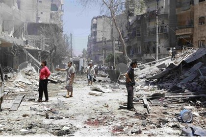 Damage from barrel bomb in Aleppo's district of Sukari