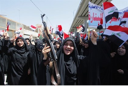 Iraqi Shia women march in support of the government against ISIS