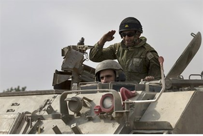 IDF soldiers in an armored personnel carrier near the Gaza border (7 July 2013)