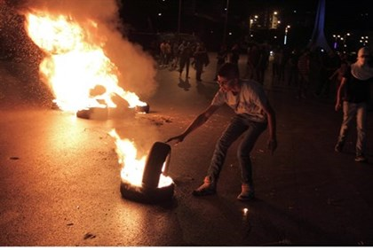 Rioters burn tires during clashes with IDF near Ramallah