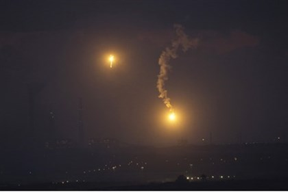 Lighting flares over Gaza