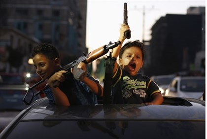 "Palestinian children in Gaza celebrate ceasefire announcement ""victory"""
