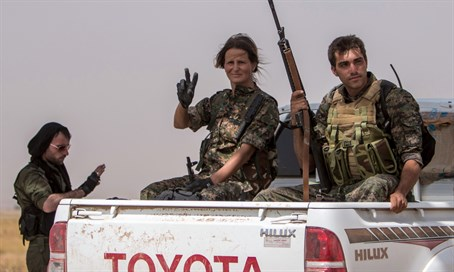 Kurdish YPG forces battling ISIS In Syria