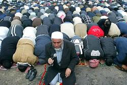 Muslims in prayer led by radical cleric Salah