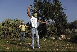 Bil'in rioters with 'nonviolent' weapons.