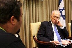 Peres listens to terror victim's father.