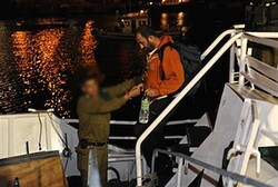 IDF soldier helps flotilla member off ship