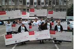 Raananim holds 'checks' in protest