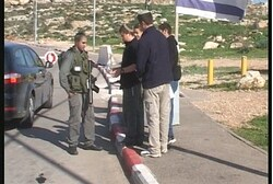 Residents warn soldiers at IDF checkpoint